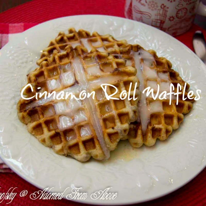 Cinnamon Roll Waffles from Adorned From Above - Ingredients: Grands Cinnamon Rolls, Butter,  Directions:  Heat up your waffle iron.  Using a pastry brush, brush some melted butter in the bottom of the waffle iron.  Place your cinnamon roll in the center of the waffle iron and then brush the top of the cinnamon roll with butter.  Push the top of the waffle iron down, and you may have to hold it in place for a minute, because the cinnamon roll will want to expand and push the top up.  You want it to be flat.  Cook it as you would a waffle and remove it when it is done.  My waffle iron has a light that goes off when it is done.  Remove the waffle from the waffle iron and brush with more melted butter.  Then spread some of the cinnamon roll frosting on top of the waffle.  I did this once I had the next waffle in the waffle iron.  Repeat this process for the rest of the waffles.  This makes 5 Cinnamon Roll Waffles with the Grands.