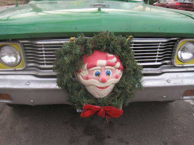Close up of the grille, with yellow around the headlights and a retro Santa wreath at center
