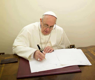 Pope Francis writing