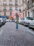 person with umbrella on Paris street