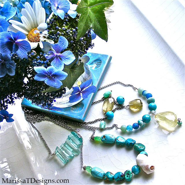 Aqua Turquoise, Aqua Spike Quartz, Sea Blue Agate Necklaces & Flowers from my Garden. Kai Candle being used as vase & Italian Shell Coaster from Starbucks.
