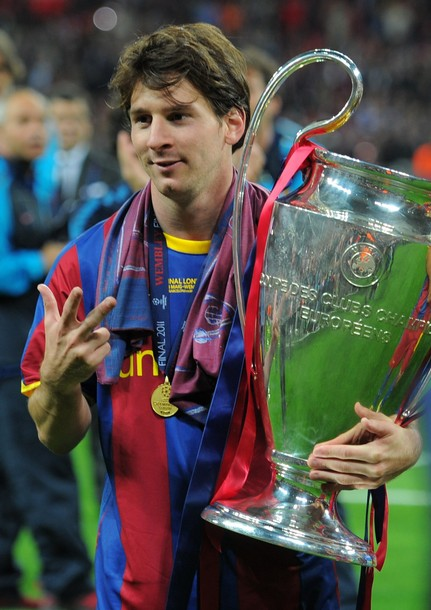 Barcelonas Argentinian Forward Lionel Messi Celebrates With The Trophy At End Of UEFA Champions League Final Football Match FC Barcelona Vs