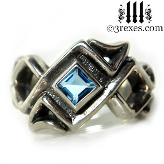 mens celtic knot wedding ring with december blue topaz stone sterling silver