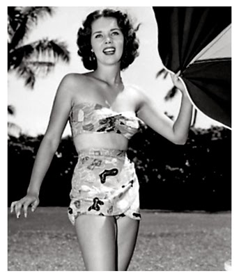 http://pinups-gogo.tumblr.com/post/59729175028/sally-forrest-1950