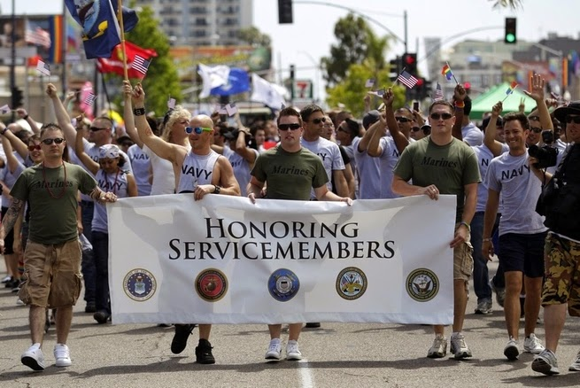 25 Photos Of People Who Will Inspire You - U.S. gay service members rally during a gay pride parade for the first time.