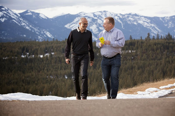 Satya Nadella (left) with Stephen Elop (right)