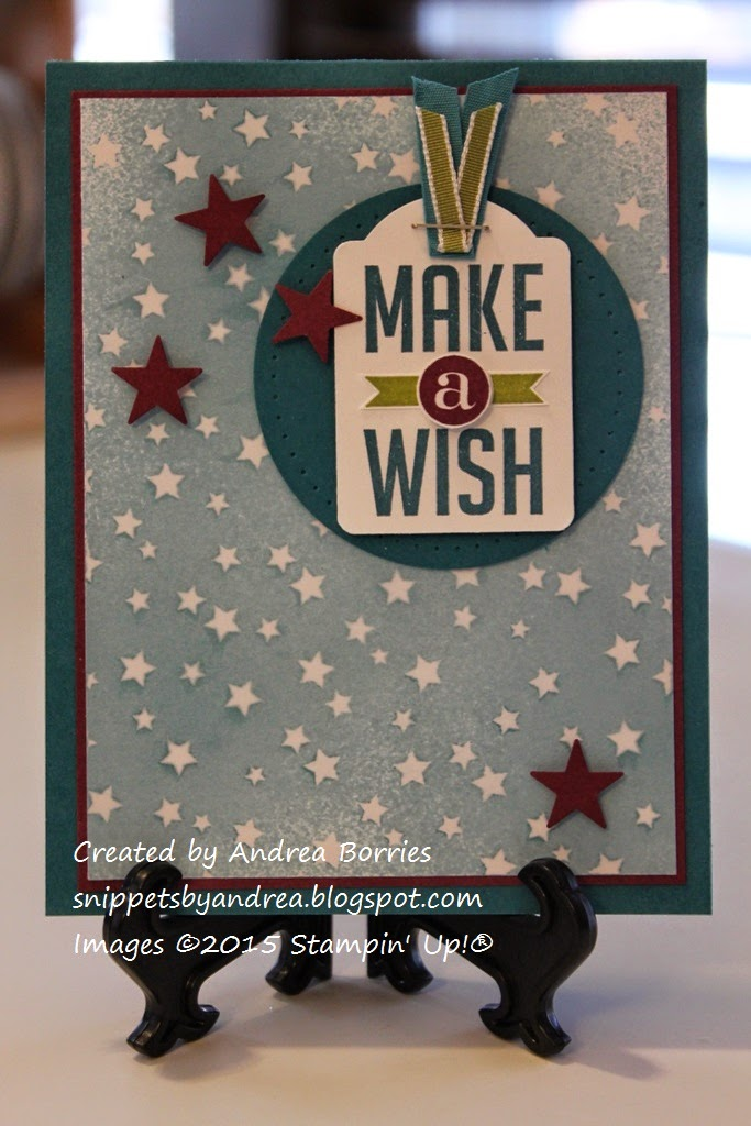 "Birthday card with a background of star-printed paper. A dark blue circle highlights a tag with the sentiment ""Make a wish,"" and small punched stars add embellishment."