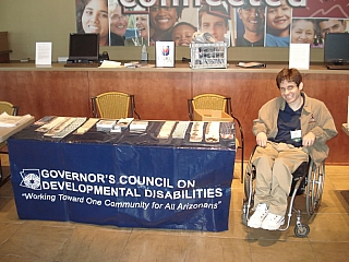 A man in wheelchair at a conference on developmental disabilities