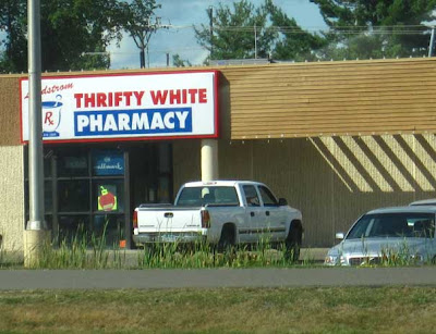 Store with sign reading Thrifty White Pharmacy