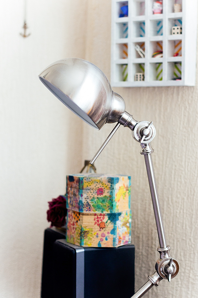 chrome lamp and painted boxes