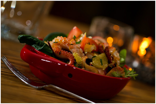 A photograph of Octopus and Orange Salad