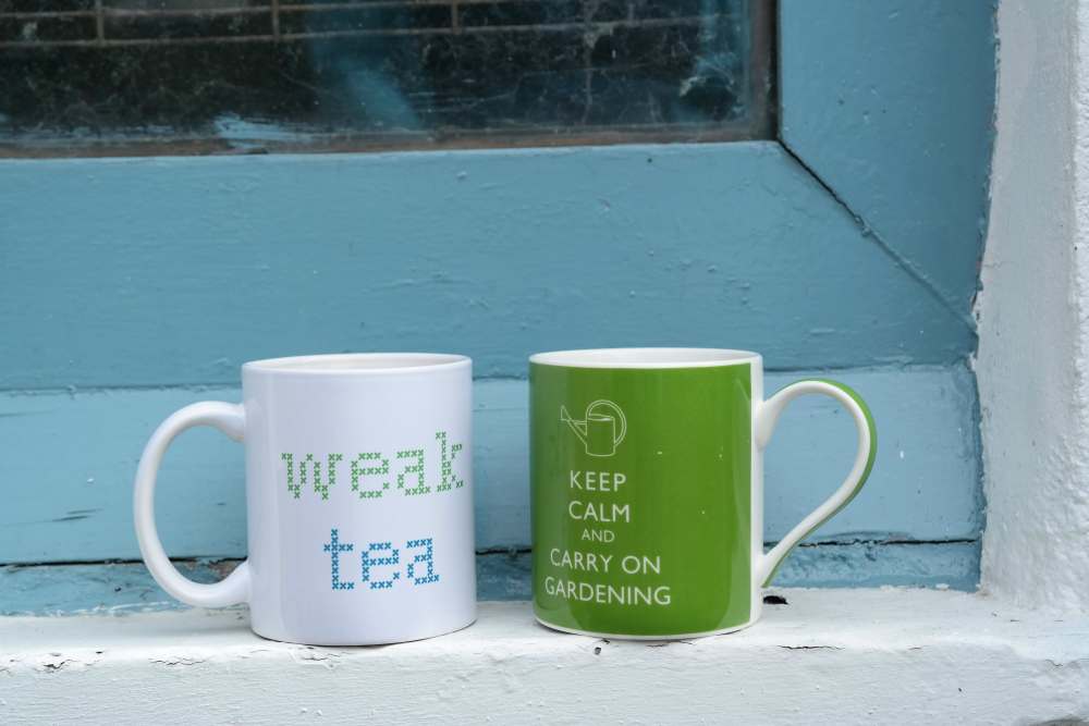 Mugs of tea on shed window ledge