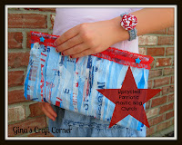 http://ginascraftcorner.blogspot.com/2013/06/upcycled-patriotic-clutch-made-from.html