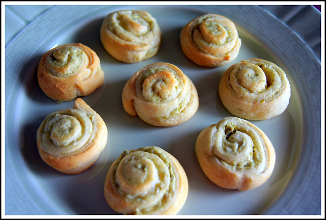 Karen cooks jalapeno cream cheese swirls for Canape aperitif