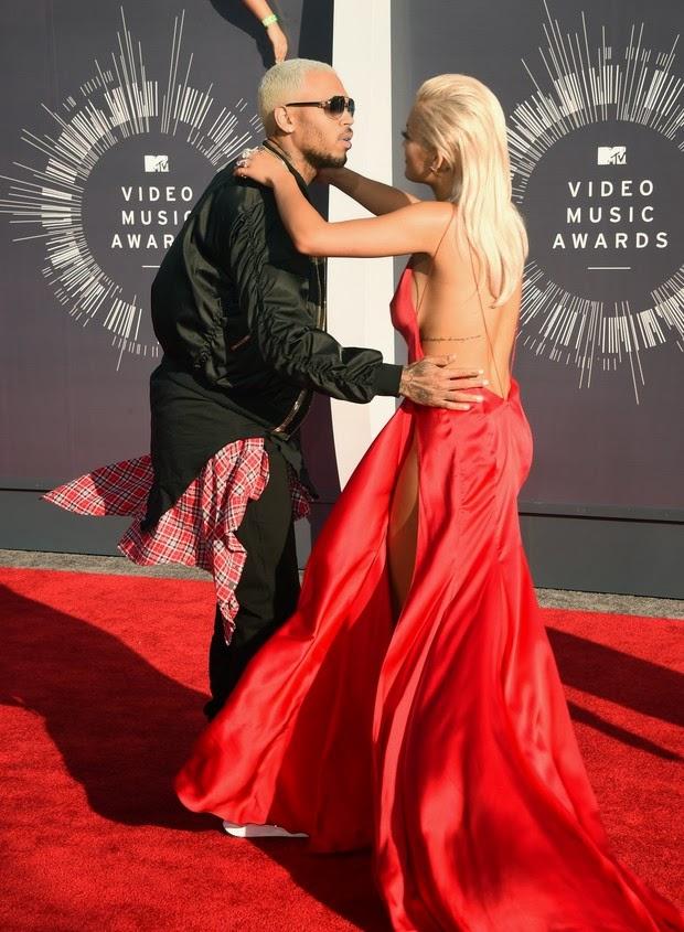 Rita Ora gets kiss from Chris Brown