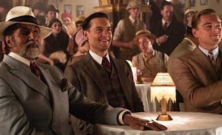 Veteran Indian actor Amitabh Bachchan as Meyer Wolfsheim, Tobey Maguire as Nick Carraway, Leonardo DiCaprio as Jay Gatsby in The Great Gatsby, Directed by Baz Luhrmann