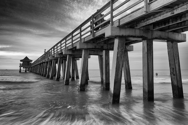 Long exposure of rushing water under the pier in Naples