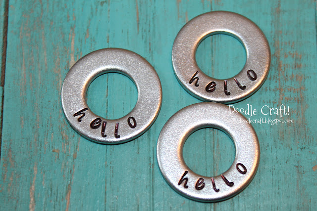 http://www.doodlecraftblog.com/2013/07/handstamped-washer-necklaces.html