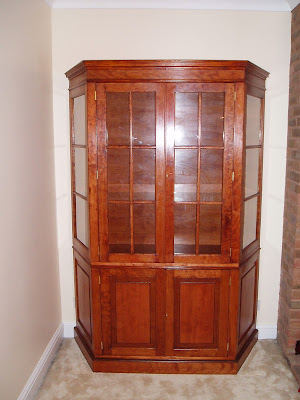 A photograph of a made to order cabinet in a client's house