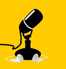 black microphone on a yellow background with iPod headphones attached