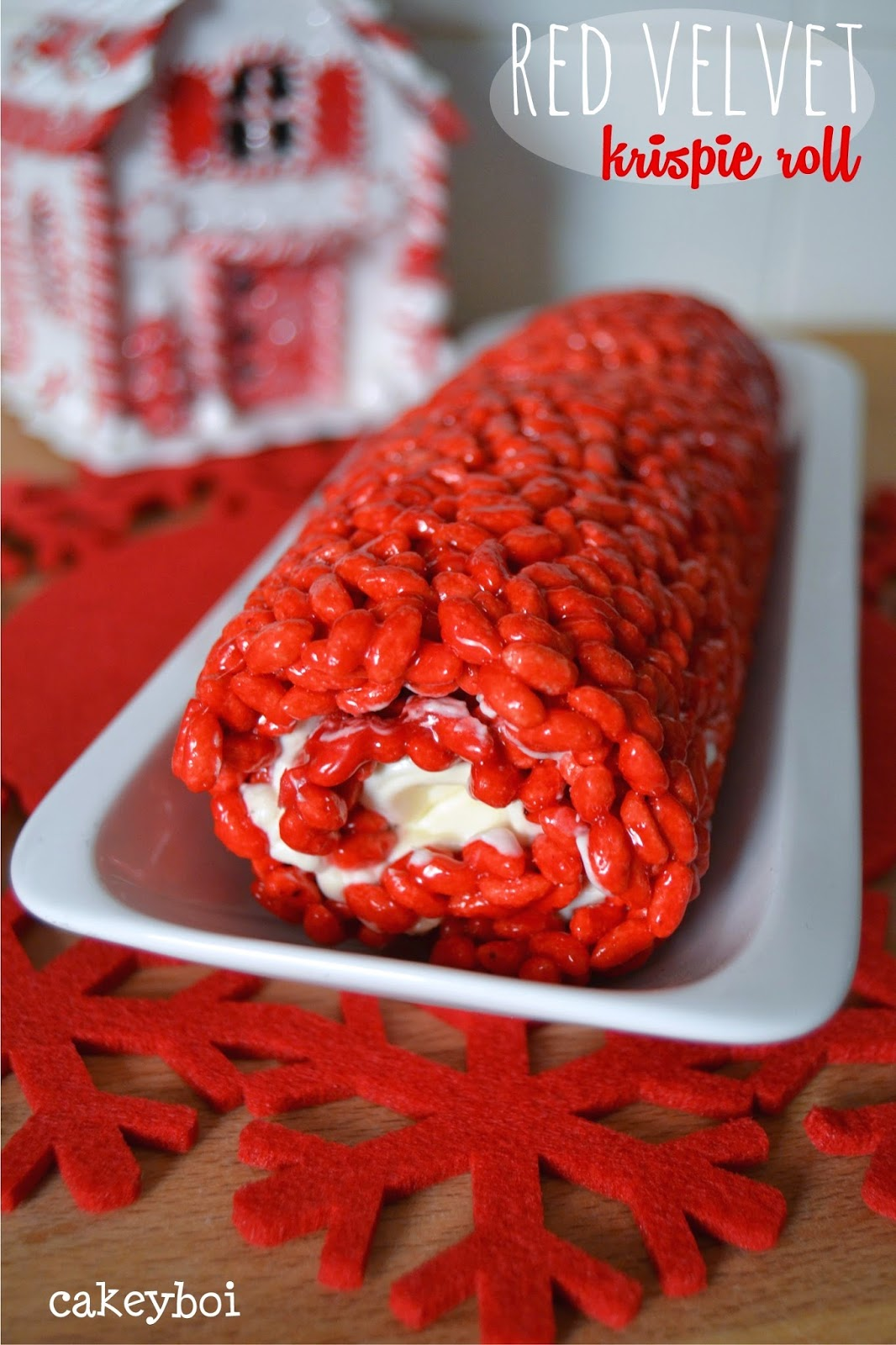 red velvet krispie treats in a festive log shape