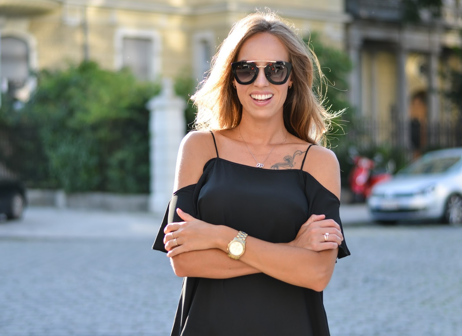 kristjaana mere black off shoulder top summer outfit
