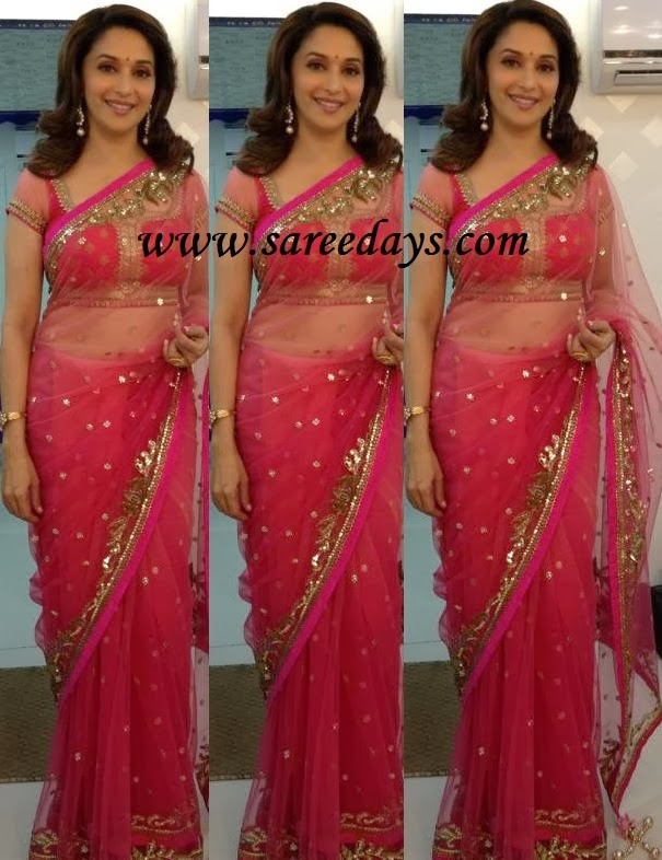 Latest saree designs madhuri dixit in pink netted designer saree checkout madhuri dixit in pink netted designer saree with gold polka dots and gold work border and paired with matching short sleeves blouse altavistaventures Images