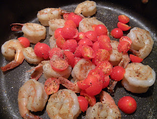 Shrimp and Tomatoes in Skillet with Salt and Pepper on top