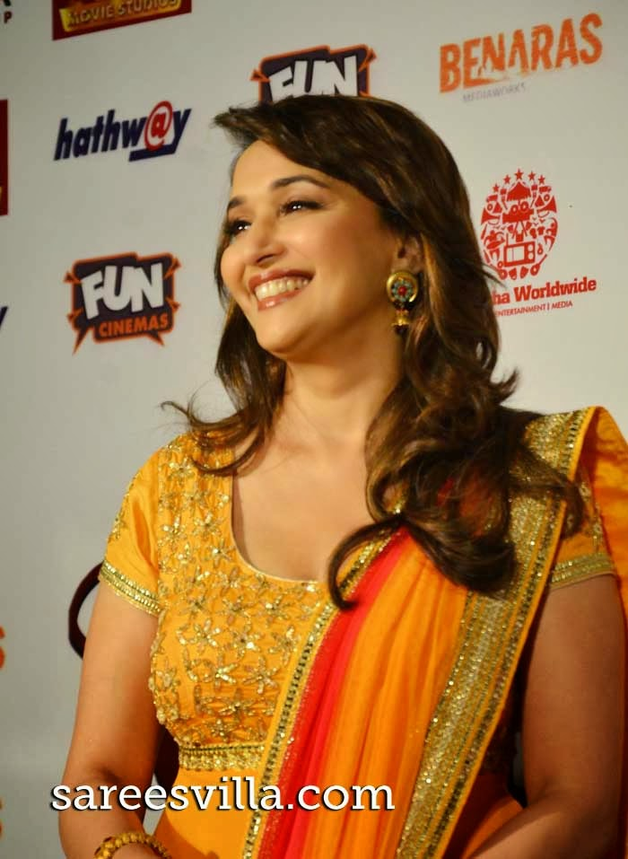 Actress Madhuri Dixit in yellow anarkali