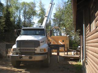 crane installing frame trusses, www.huismanconcepts.com