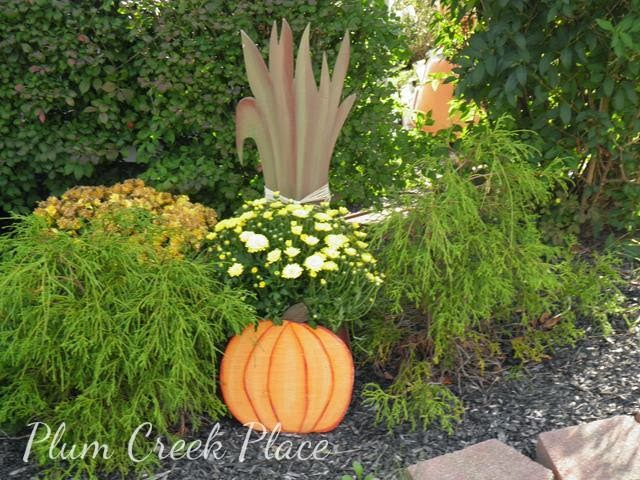 Pumpkin planter with cornstalks
