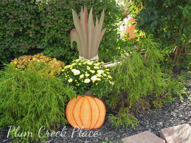 Pumpkin planter with cornstalks
