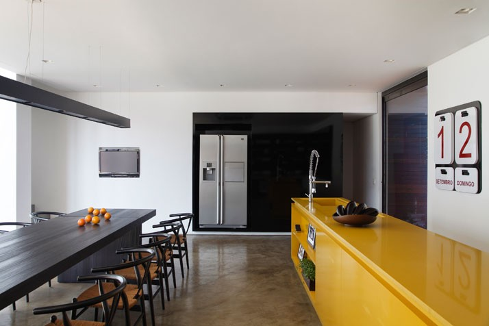 The house is all at once harshly geometric and simple yet luxurious and sleek the metal and concrete materials add an industrial quality yet the wooden