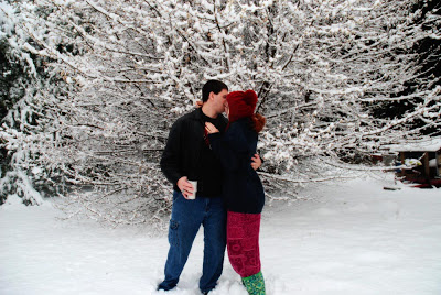 couple snow kiss