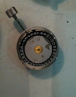 the old isa 1198 movement  note the white on black date wheel of the