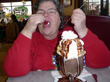 woman eating a huge sundae