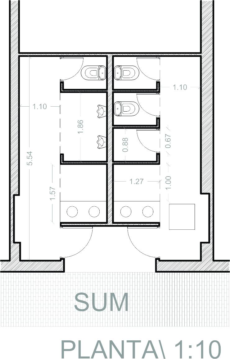 Detalle De Un Baño En Planta:baños de distribución simétrica se organizan en base a una serie de