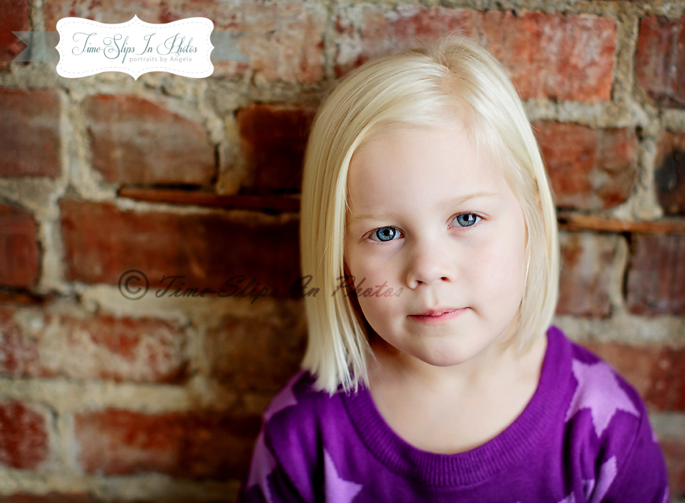 blond_toddler_girl_purple_star_sweater