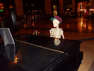 skeleton at piano
