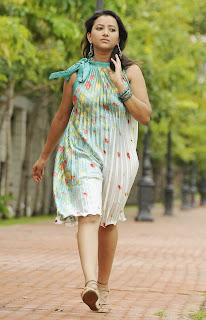 Swetha Basu Prasad in Green Dress Movie Stills