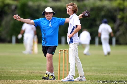L-R: Peter Smith, umpire, signals a wide for Grayden Carr, bowler, Napier Boys High School, cricket vs Wanganui Collegiate, Wanganui, second day of a week-long year 9 and 10 tournament at Napier Boys High School, Napier. photograph
