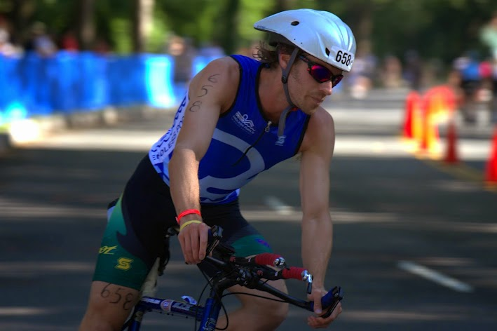 Endless Pools' Applications Engineer Adam Alper competes in the bike leg of a triathlon.