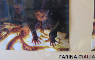 photo of: Reggio Emilia children explore sensory materials on light table