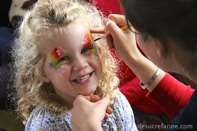 Lilly getting her face painted at the annual school fair in London, England.