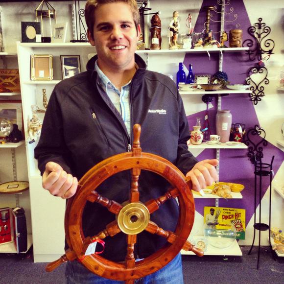 Boy holding captain's wheel