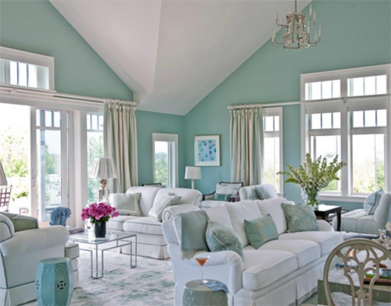 white slipcover sofas in aqua coastal room