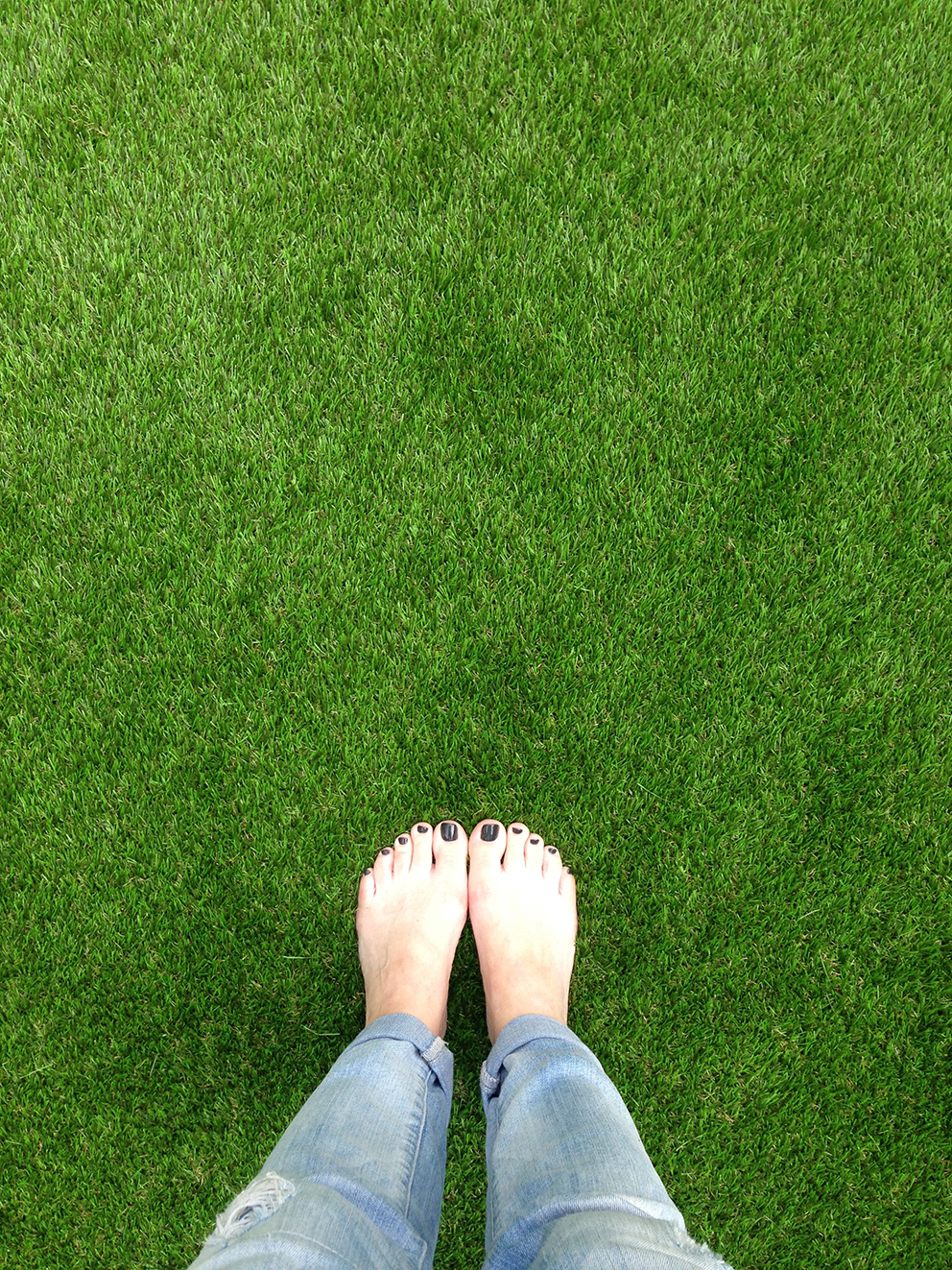 Feet on artificial lawn - French For Pineapple Blog