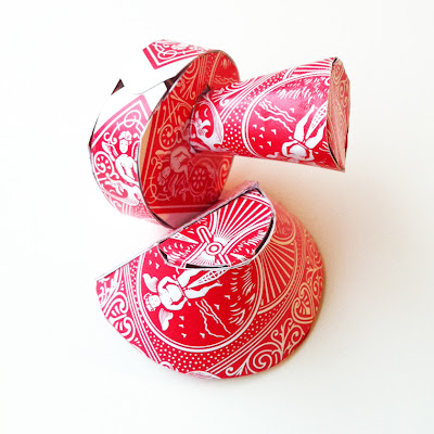 A small scale sculpture constructed out of red playing cards.