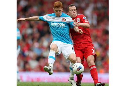 Liverpool's Charlie Adam tussles for possession with Sunderland's Jack Colback