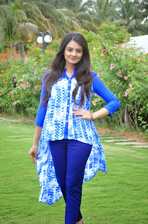 Nikitha Narayan in Purple Kurta and Stylish Blue Top Smiling Beauty in Pessaraatu Movie